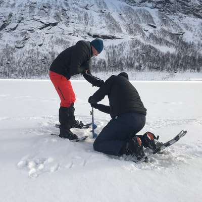 learn icefishing in arctic snow landscape in Norway